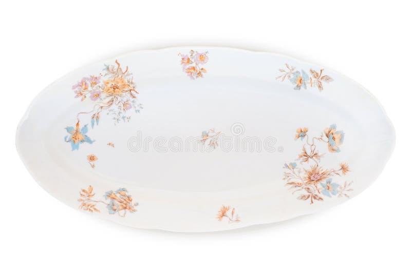 L'antiquité a décoré le long plat de porcelaine d'isolement sur le blanc avec du Cl photo stock