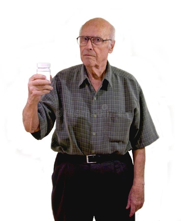 L'anziano riflette i meds in linea immagine stock