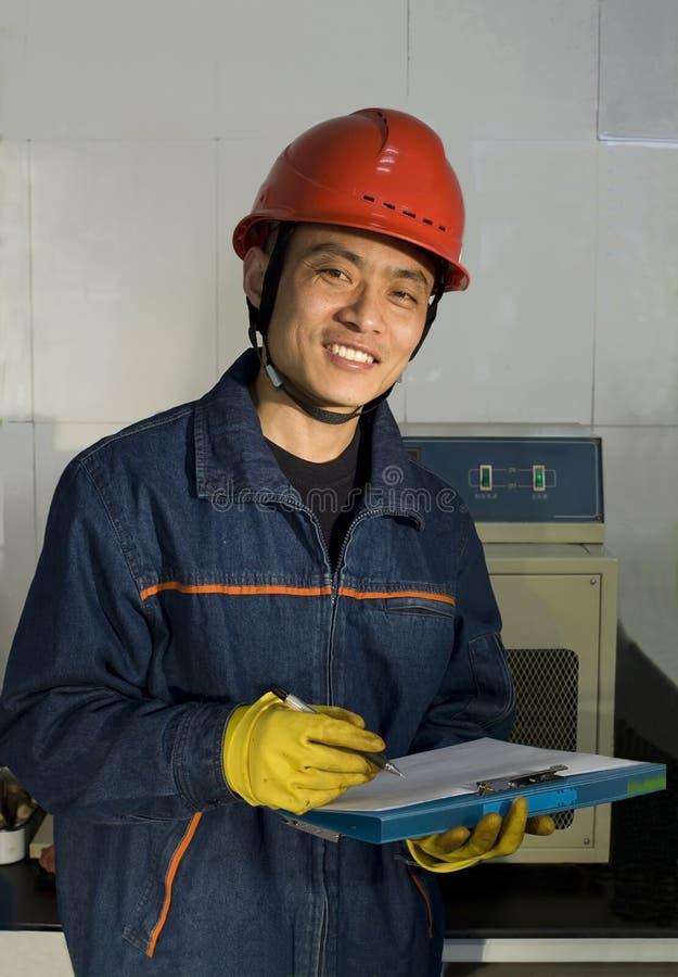 L'appareil de contrôle est enregistrement et sourire photographie stock