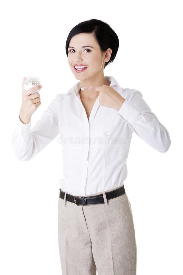 L'apparence de femme d'affaires a abouti l'ampoule image libre de droits
