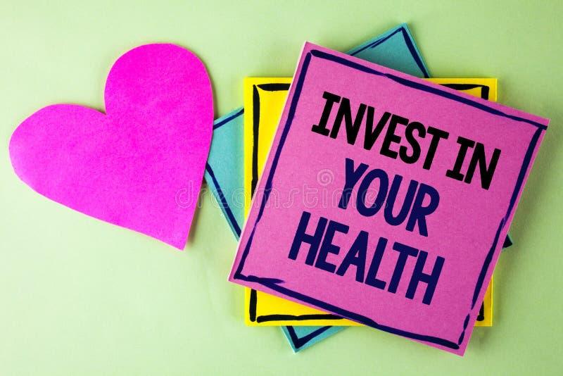 L'apparence de note d'écriture investissent dans votre santé La présentation de photo d'affaires dépensent l'argent dans les essa photos stock