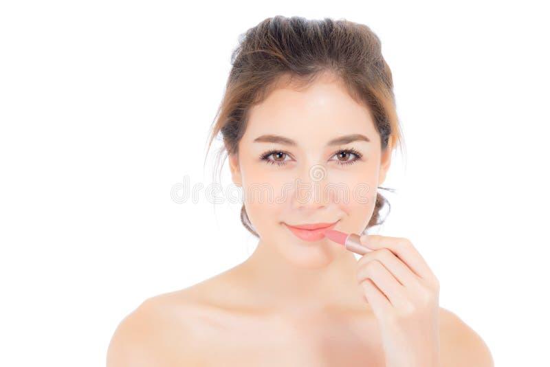 L'application asiatique de femme de beauté composent avec le rouge à lèvres de la bouche d'isolement photographie stock libre de droits