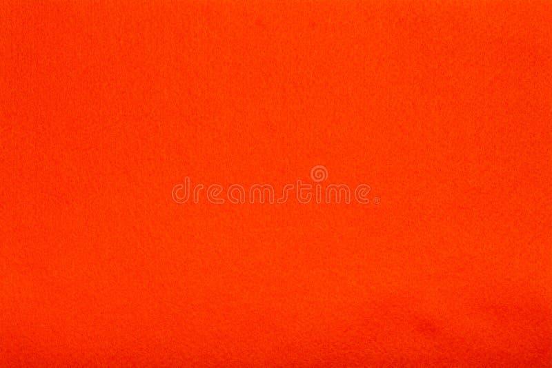 L'arancia ha ritenuto il panno del tessuto, fondo di struttura del primo piano immagini stock