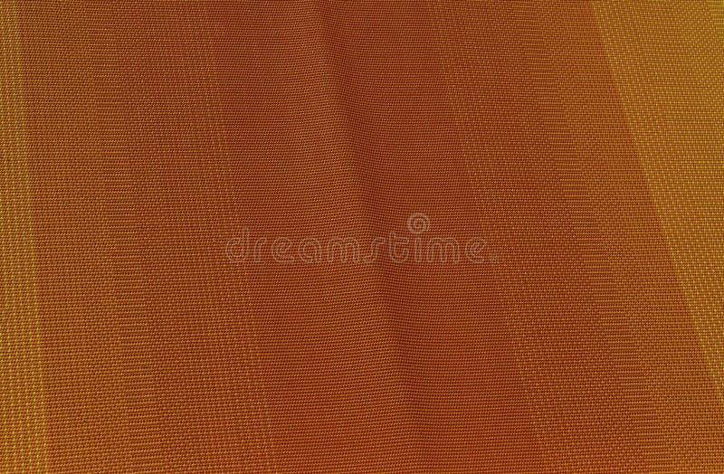 L'arancia rossa intensa luminosa ha allineato il tessuto dalla Sicilia fotografia stock