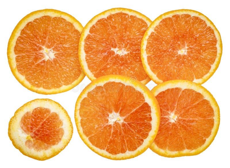 L'arancio fresco affetta la priorità bassa immagine stock