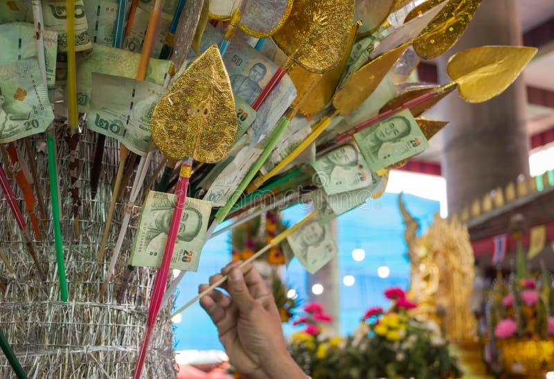 L'argent font le mérite photographie stock libre de droits