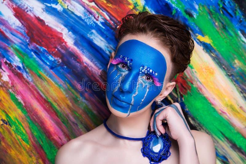 L'art bleu de femme composent image stock
