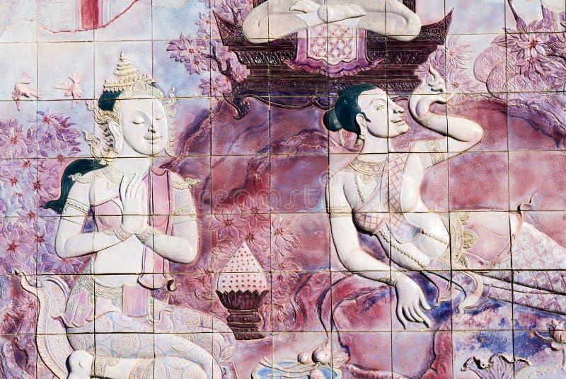 L'art sur un mur dans le temple de la Thaïlande image stock