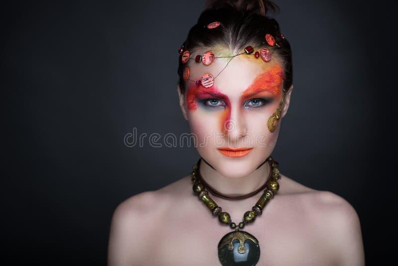 L'arte della donna compone fotografie stock libere da diritti