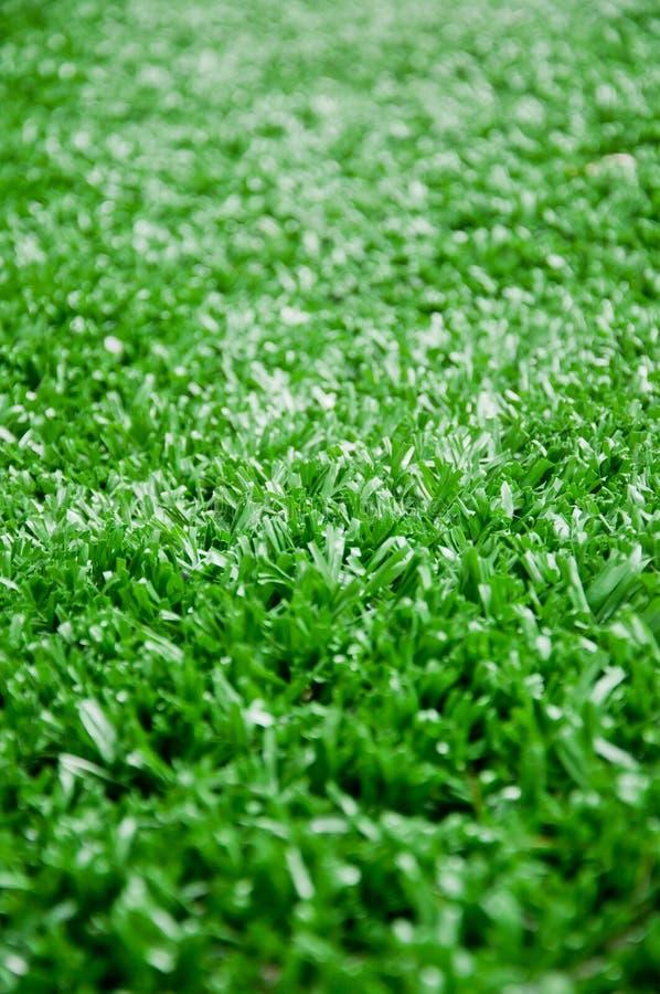 L'astroturf pour le football comme fond images stock