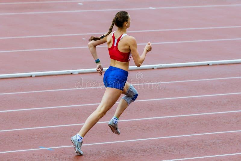L'athlet de fille courent 400 mètres photographie stock