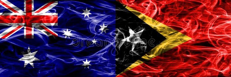 L'Australia contro la bandiera variopinta del fumo di Timor orientale fatta di fumo spesso illustrazione di stock