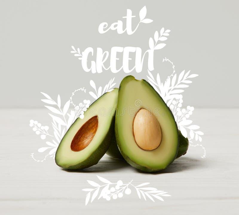 l'avocado verde organico, pulisce il cibo del concetto, mangia l'iscrizione verde fotografia stock