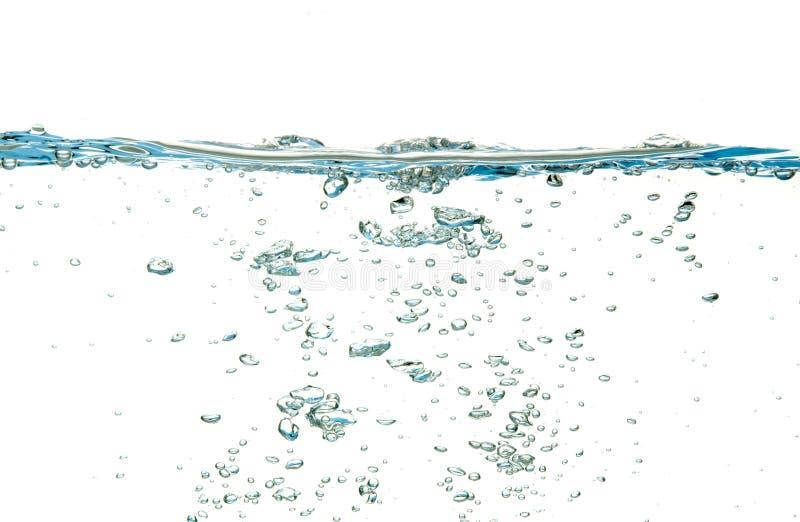 L'eau d'isolement au-dessus du blanc photographie stock libre de droits