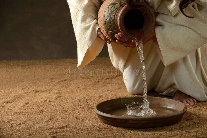 L'eau pleuvante à torrents de Jésus photographie stock libre de droits