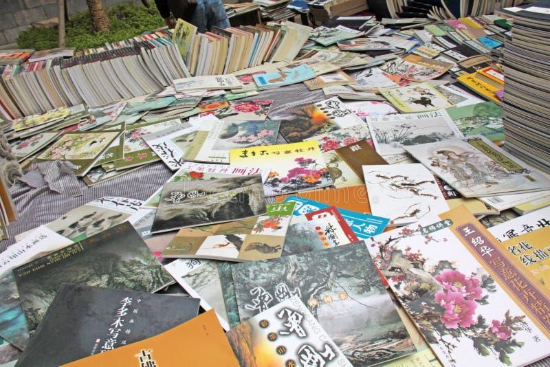 L'effondrement et la vente des livres sur la peinture chinoise et le Chinois p photos libres de droits