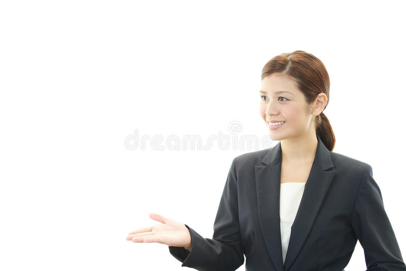Lemploy De Bureau Fminin Qui Pose Heureusement Images stock