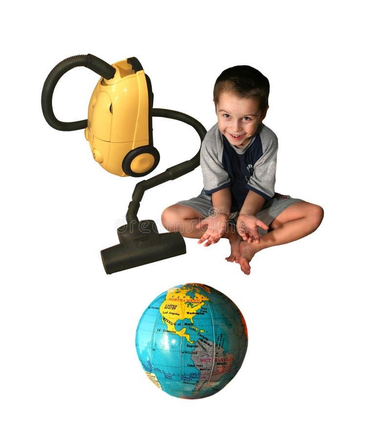 L'enfant avec un aspirateur. photos libres de droits