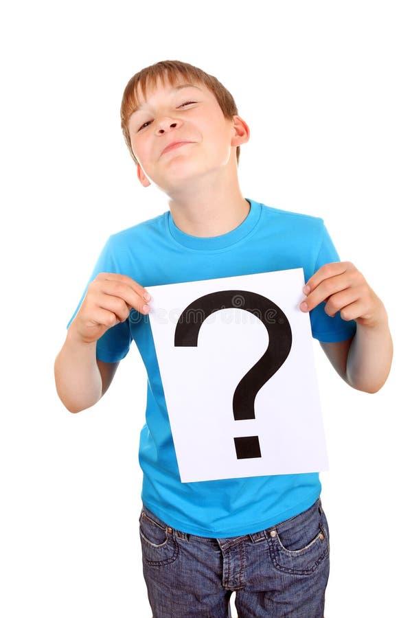 Download L'enfant Tient Le Point D'interrogation Image stock - Image du intérieur, caucasien: 45367539