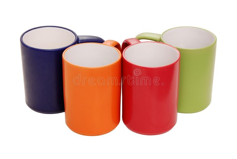 L'ensemble de tasses verdissent, orange, bleu, rouge photo libre de droits