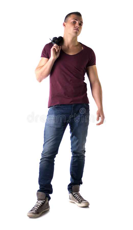 L'ente completo ha sparato del giovane bello con la maglietta ed i jeans fotografia stock