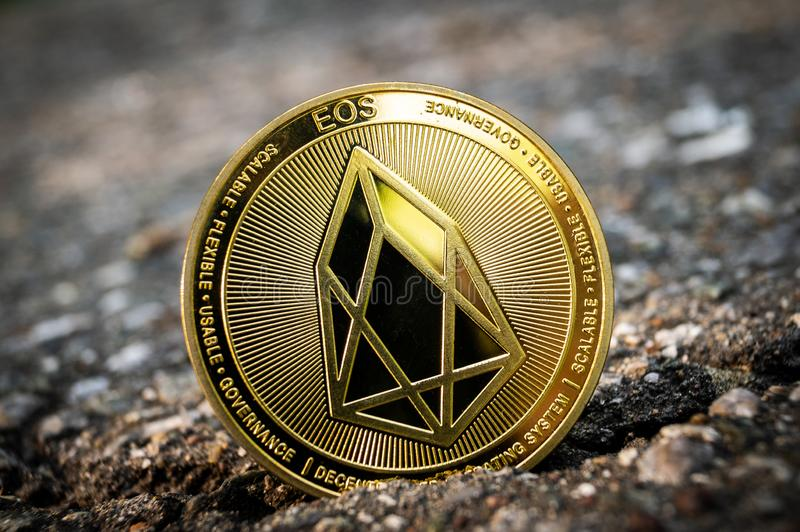 L'EOS di Eosio è un modo moderno dello scambio e questa valuta cripto è mezzi di pagamento convenienti nei mercati di web e finan fotografia stock