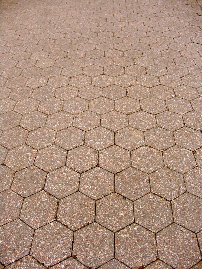 L'esagono ha coperto di tegoli il pavimento immagine stock libera da diritti
