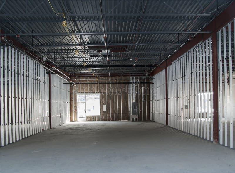 L'espace commercial en construction images stock