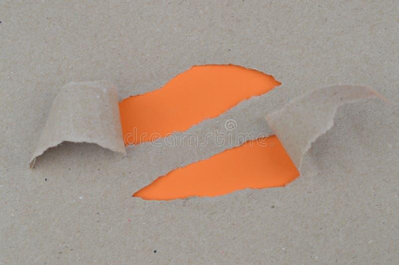 L'espace orange de indication de papier déchiré pour des mots photographie stock