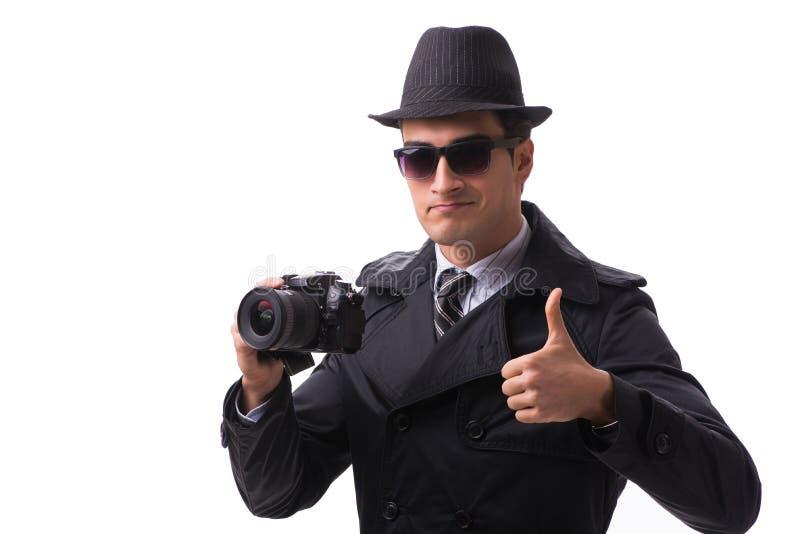 L'espion avec l'appareil-photo prenant des photos d'isolement sur le blanc photo stock