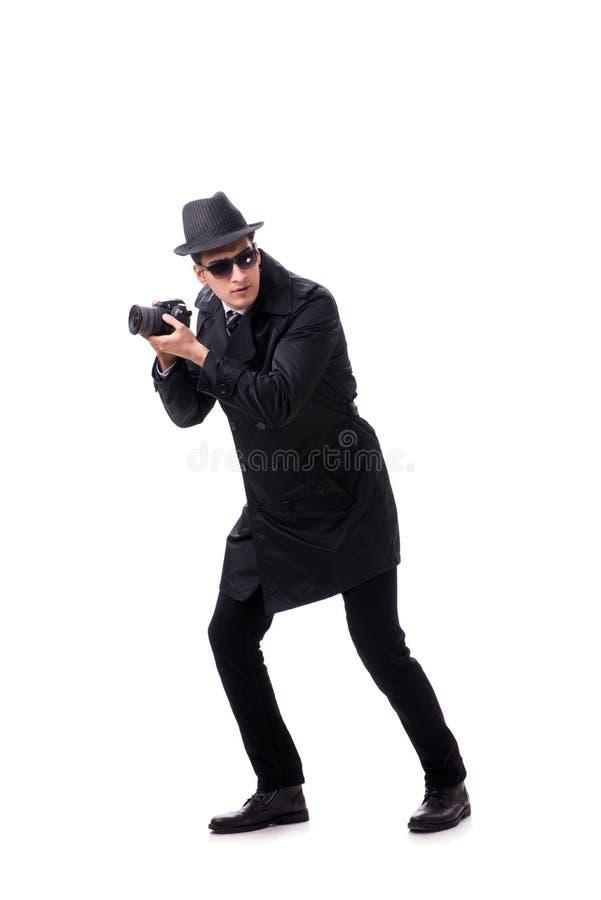 L'espion avec l'appareil-photo prenant des photos d'isolement sur le blanc photo libre de droits
