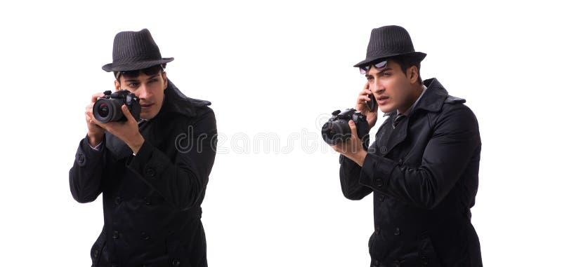 L'espion avec l'appareil-photo prenant des photos d'isolement sur le blanc photographie stock libre de droits