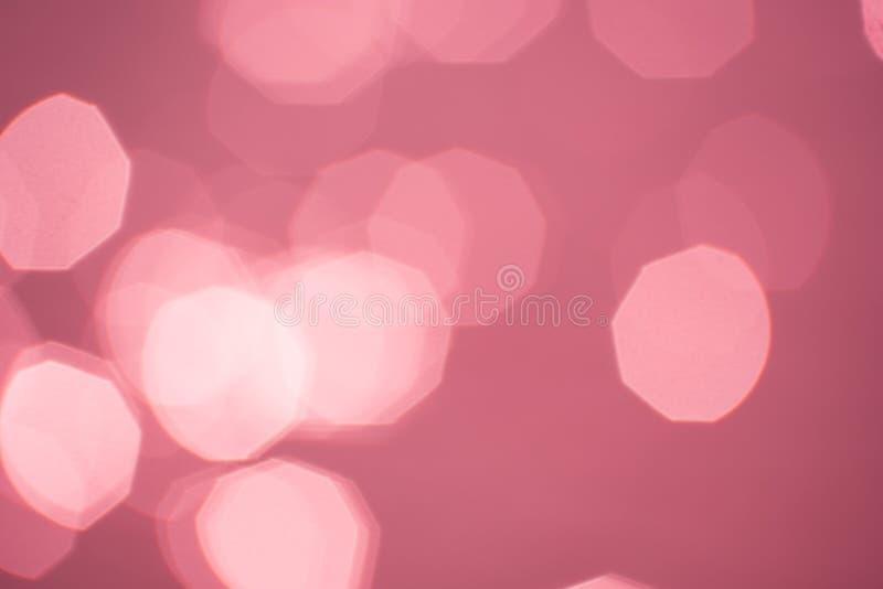 L'estratto ha offuscato il fondo rosa con bokeh, foto fotografia stock