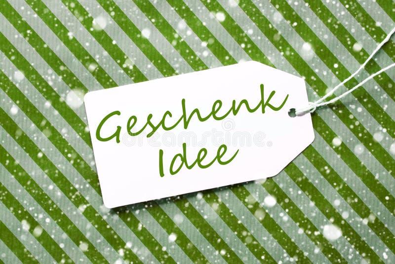 L'etichetta, carta da imballaggio verde, Geschenk Idee significa l'idea del regalo, fiocchi di neve fotografia stock