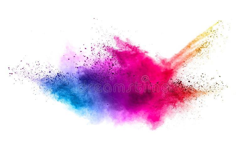 L'explosion de poudre de couleur éclaboussent alors sur le fond blanc image libre de droits