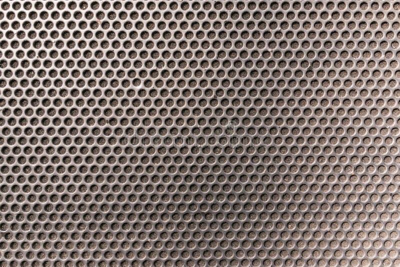 L'hexagone métallique de nid d'abeilles a grillé le modèle devant le spe de musique images libres de droits
