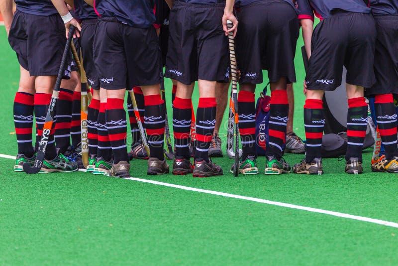L'hockey chausse des bâtons de circuits de chaussettes photos stock