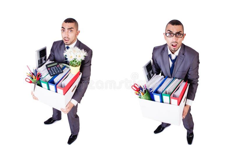 L'homme étant mis le feu avec la boîte de substance personnelle photo stock