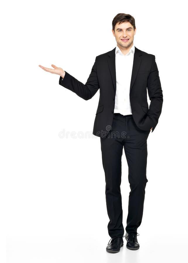 L'homme affiche quelque chose sur le bras d'isolement sur le blanc photos libres de droits