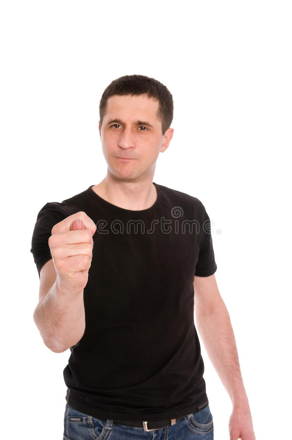 L'homme affiche une figue (l'orientation à disposition) photographie stock