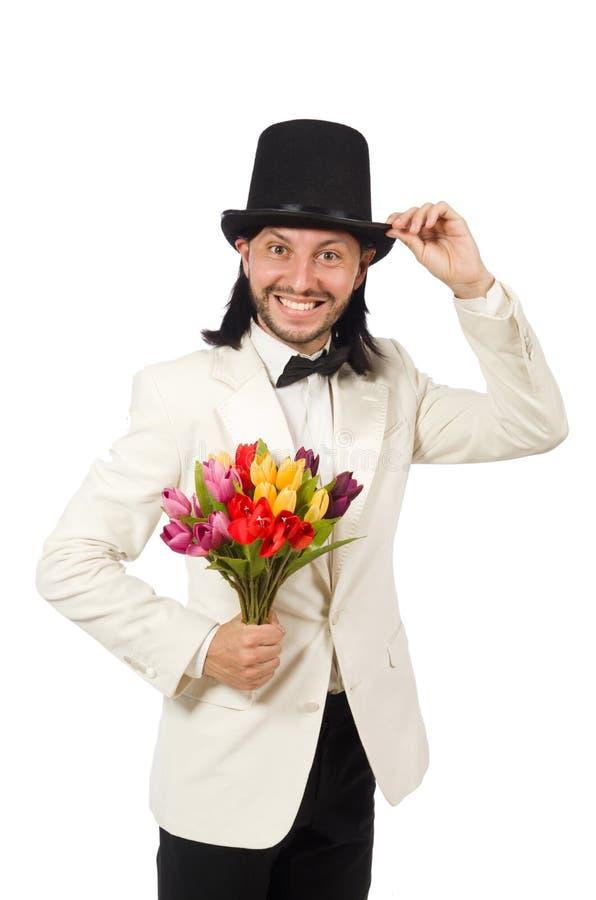 L'homme avec des fleurs de tulipe d'isolement sur le blanc images libres de droits