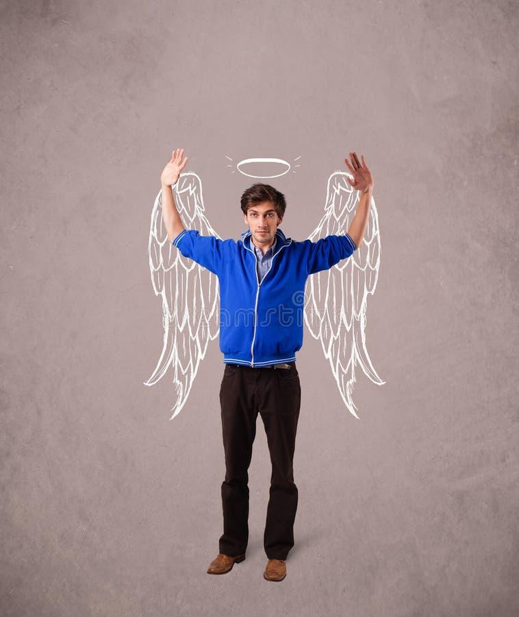 l'homme avec l'ange a illustré des ailes sur le fond sale photo stock