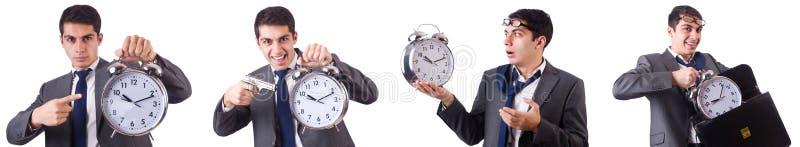 L'homme avec l'horloge d'isolement sur le blanc photographie stock