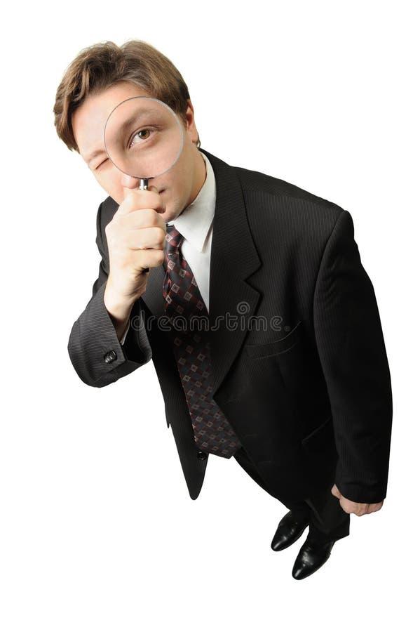 L'homme avec une loupe photo stock