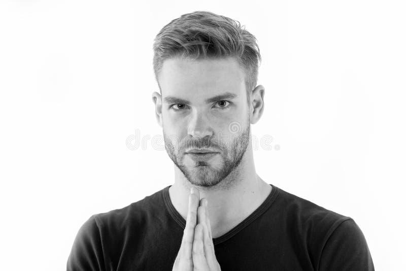L'homme barbu prient d'isolement sur le blanc La prise de prière de type remet étreint près du visage non rasé Pleine concentrati photo stock
