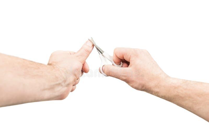 L'homme coupe ses clous photo libre de droits