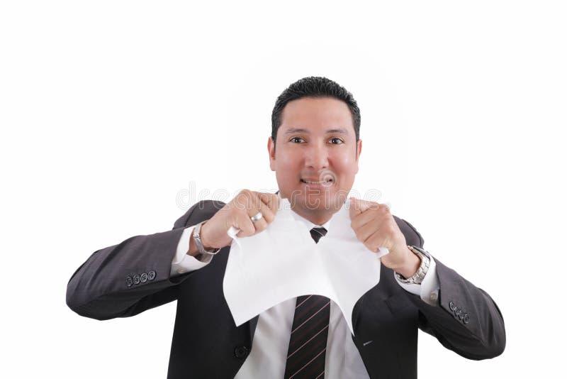 L'homme d'affaires déchire un papier de document photos stock