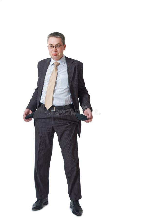 L'homme d'affaires affiche les poches vides photos stock