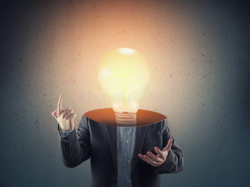 L'homme d'affaires d'ampoule photo libre de droits