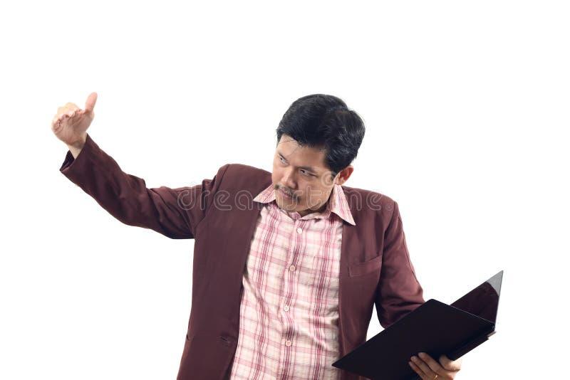 L'homme d'affaires asiatique invitant ou montrent l'isolat du doigt utilisé de signe de main sur W image libre de droits
